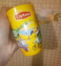 Yellow promotional cup of our Editor.