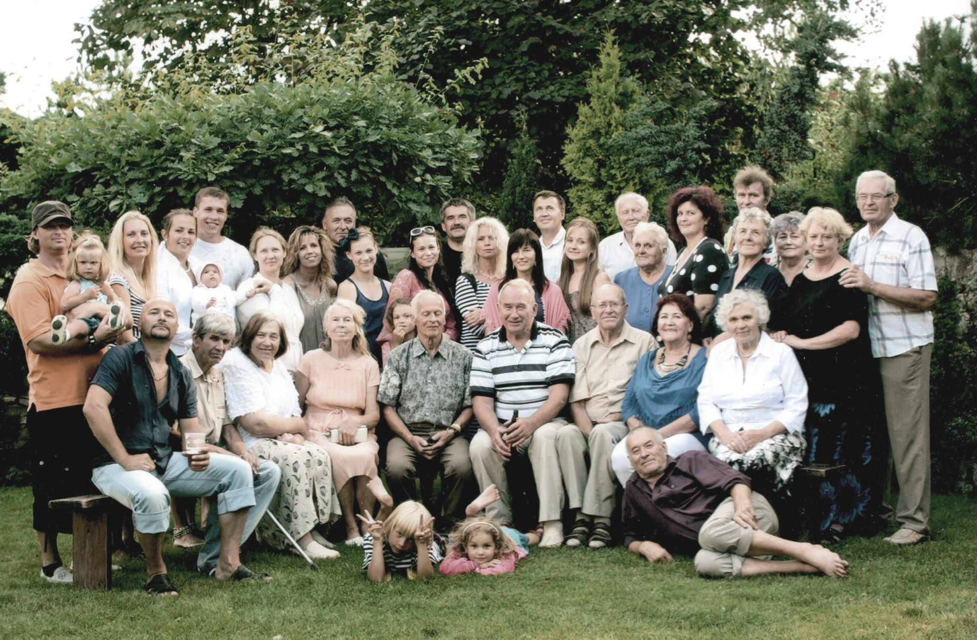 The Alberti family in 2015 at a fam- ily reunion on the property. Jānis, my grandfa- ther, is sitting in the middle (front row) wearing a striped shirt. He brings us together.