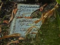 broken gravestone on the ground