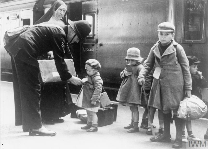 The Civilian Evacuation Scheme in Britian during the Second World. A policeman helps some young evacuees, and a nun who is escorting them, at a London station.